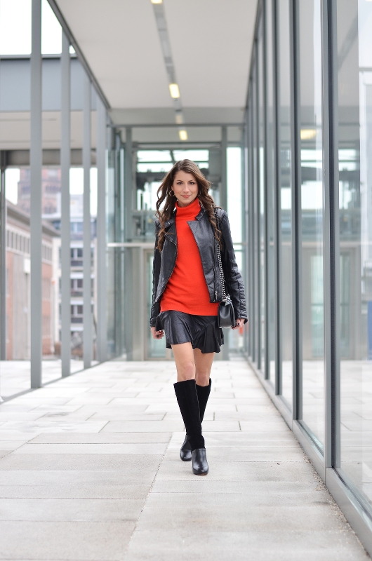 red turtleneck sweater black leatherjacket outfit