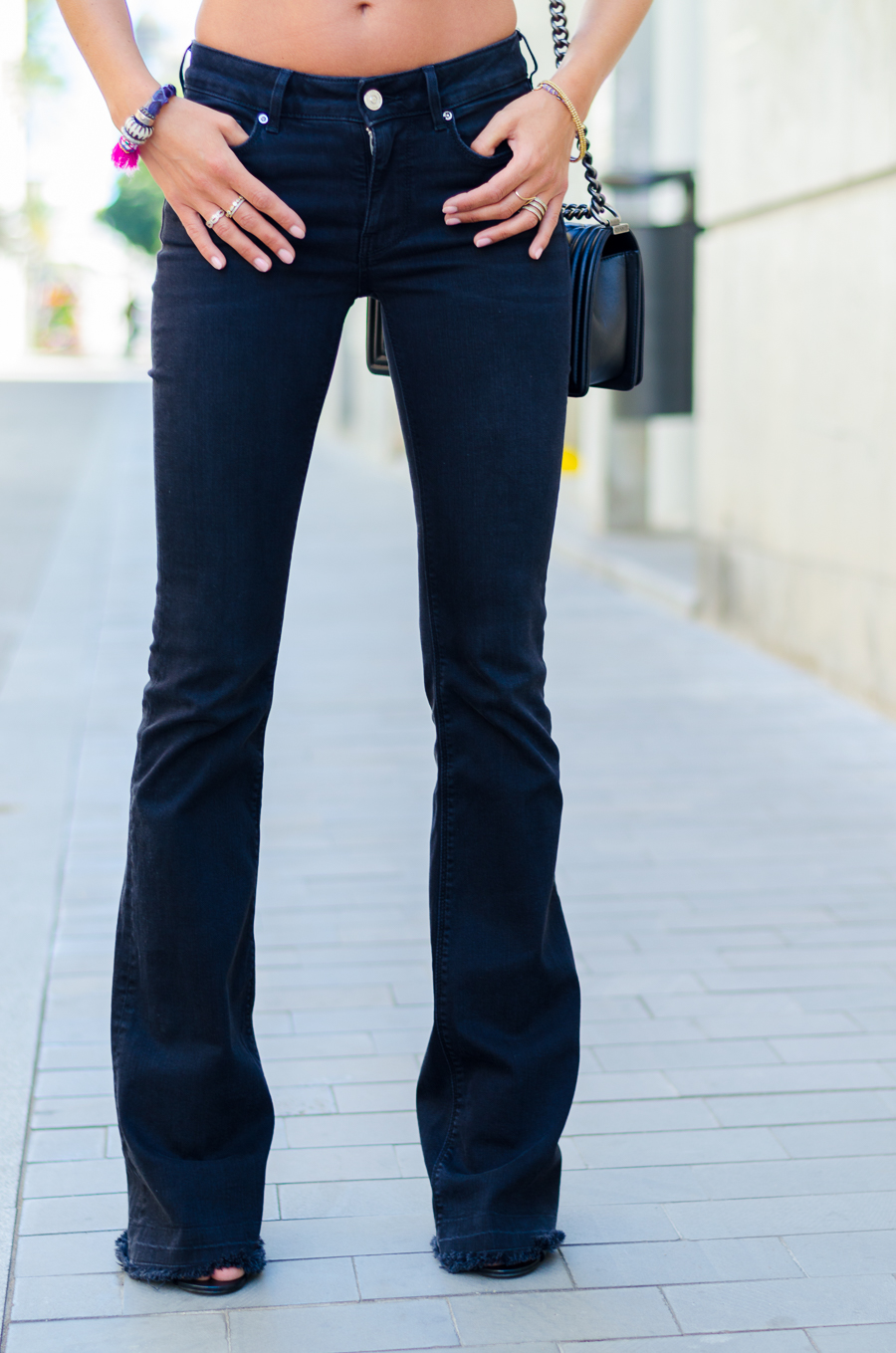 festival outfit flare jeans chanel boy bag
