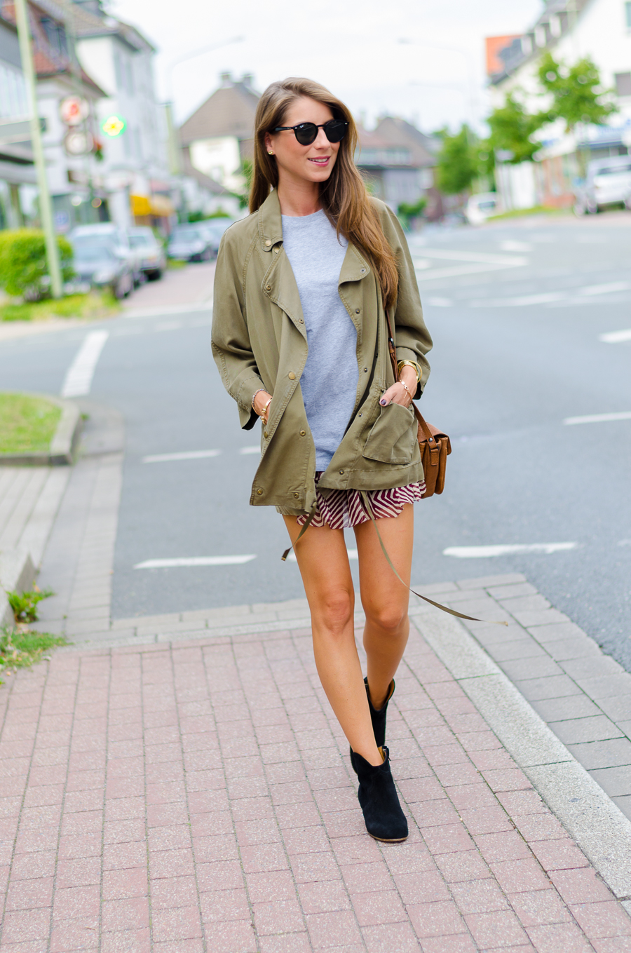military jacket and a ruffled silk skirt outfit