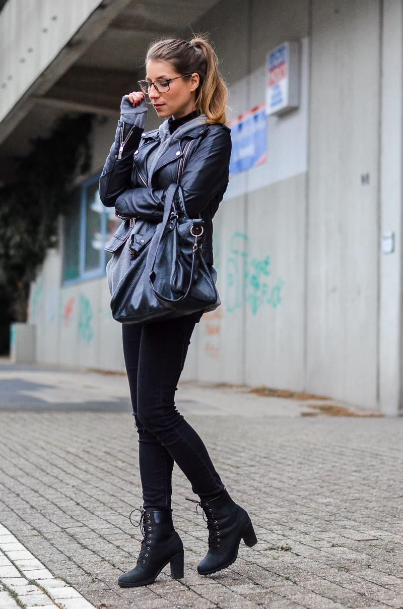 street style lederjacke hoodie schwarze jeans gucci brille outfit