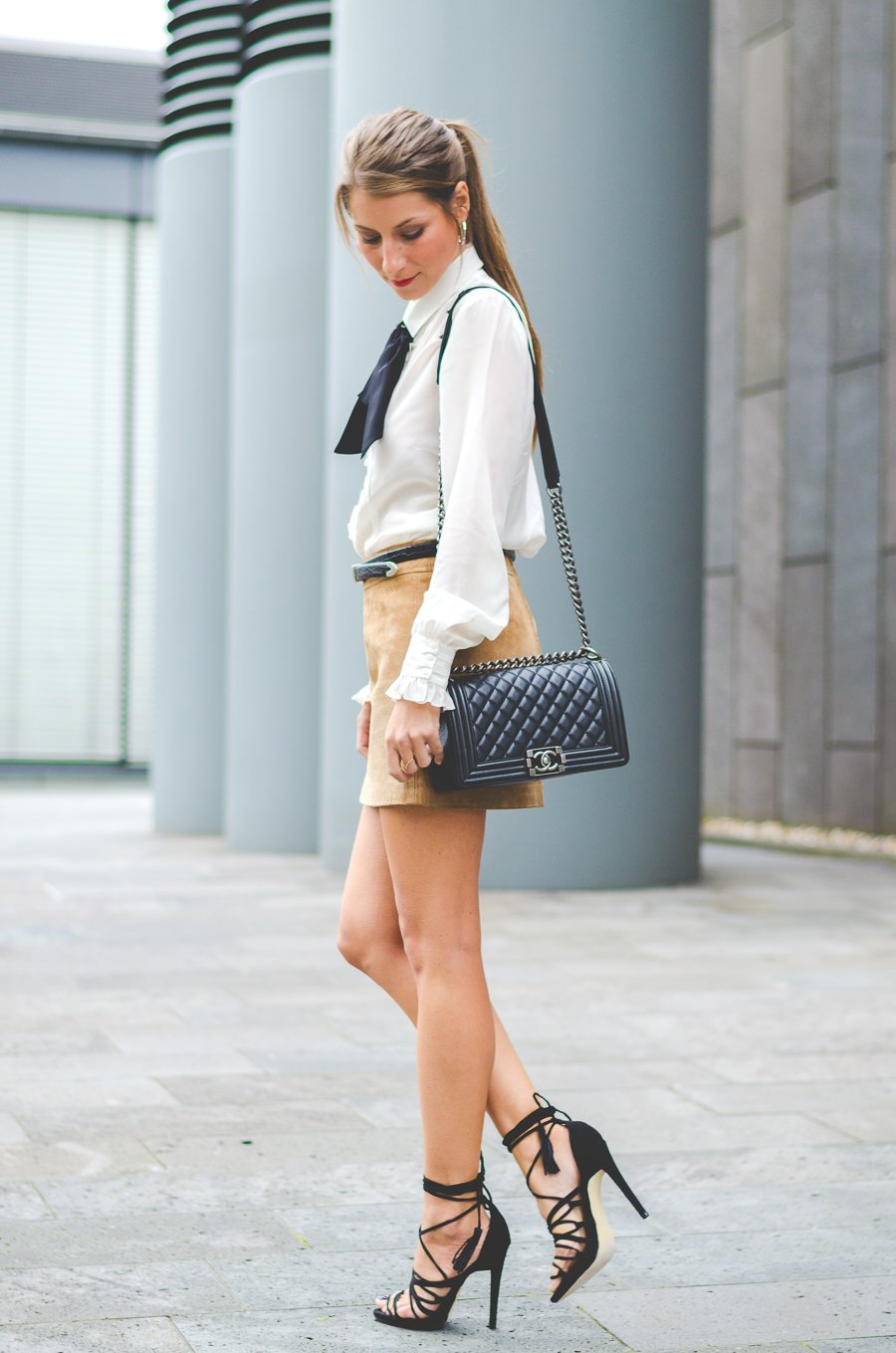 bow tie blouse leatherskirt chanel boy bag lace up heels outfit