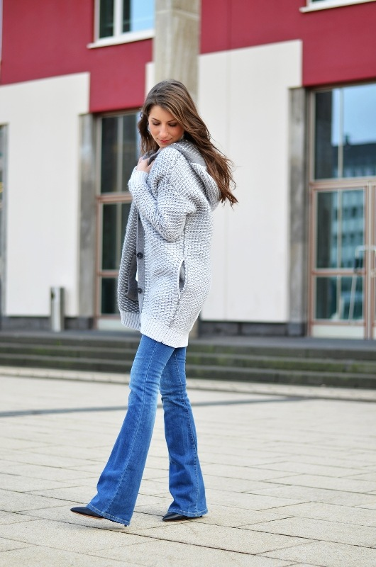 hooded cardigan knit flared jeans outfit fashion blog