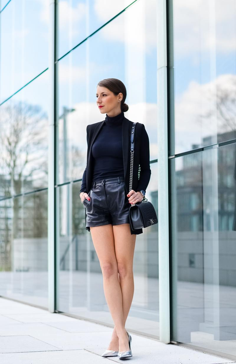 long vest leather shorts sleek and chic outfit turtleneck chanel bag