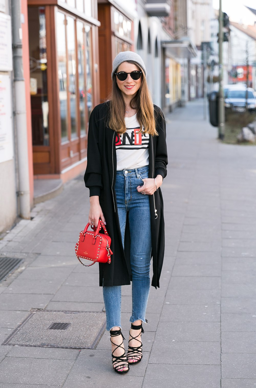 high waist skinny jeans outfit bomber jacket black coat beanie lace-up heels