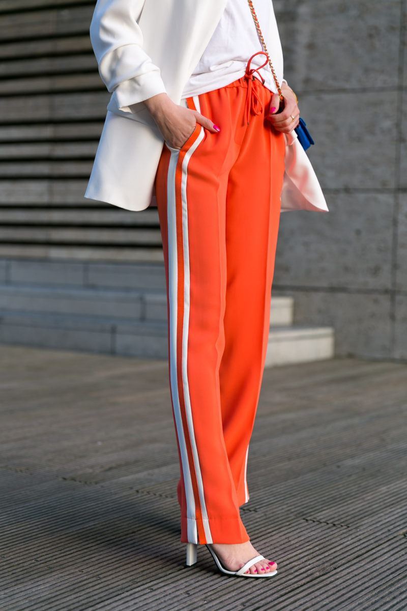 track pants stripes orange outfit white blazer heels fashion blog street style veja du