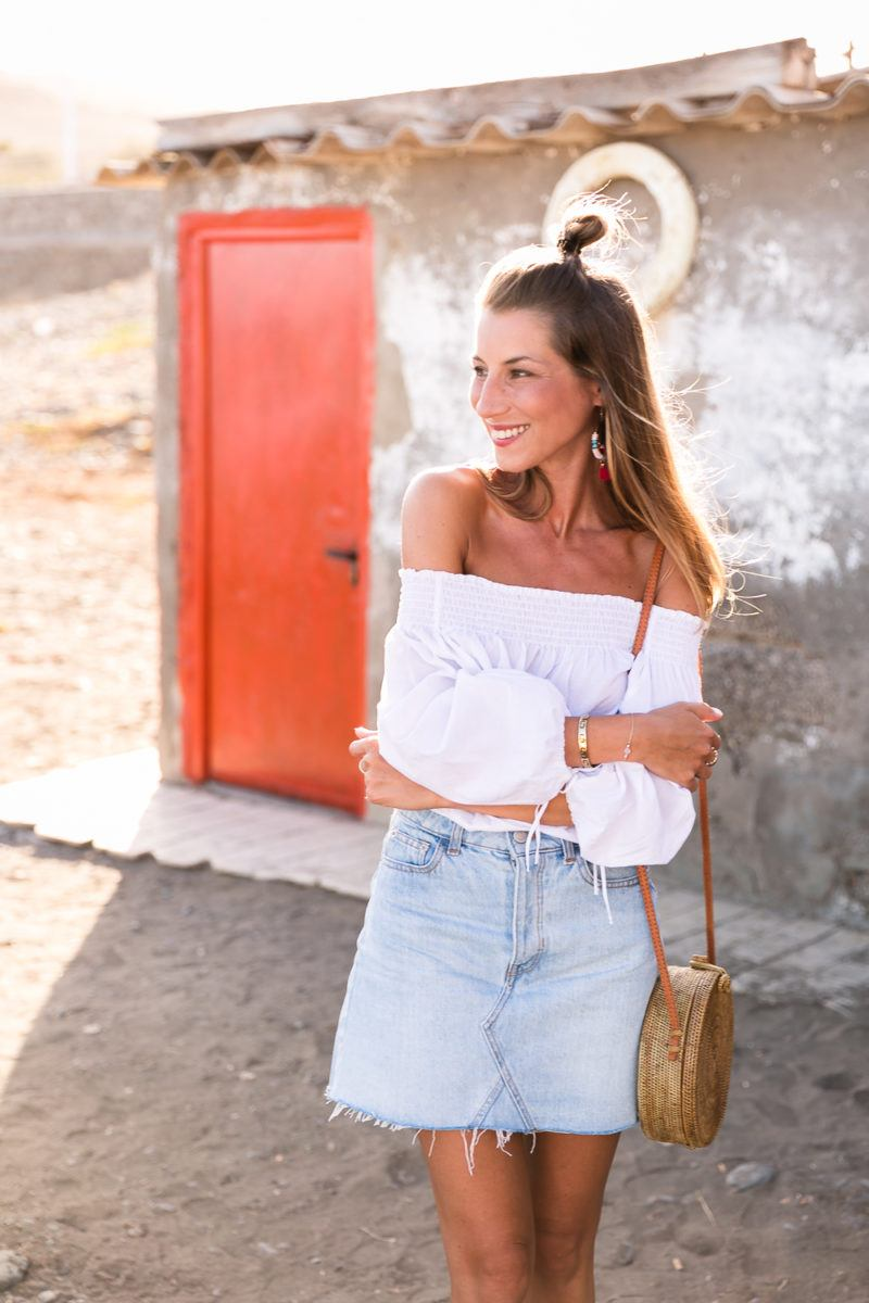 red shoes outfit jeans skirt denim off the shoulder top straw bag summerlook fashionblog 7