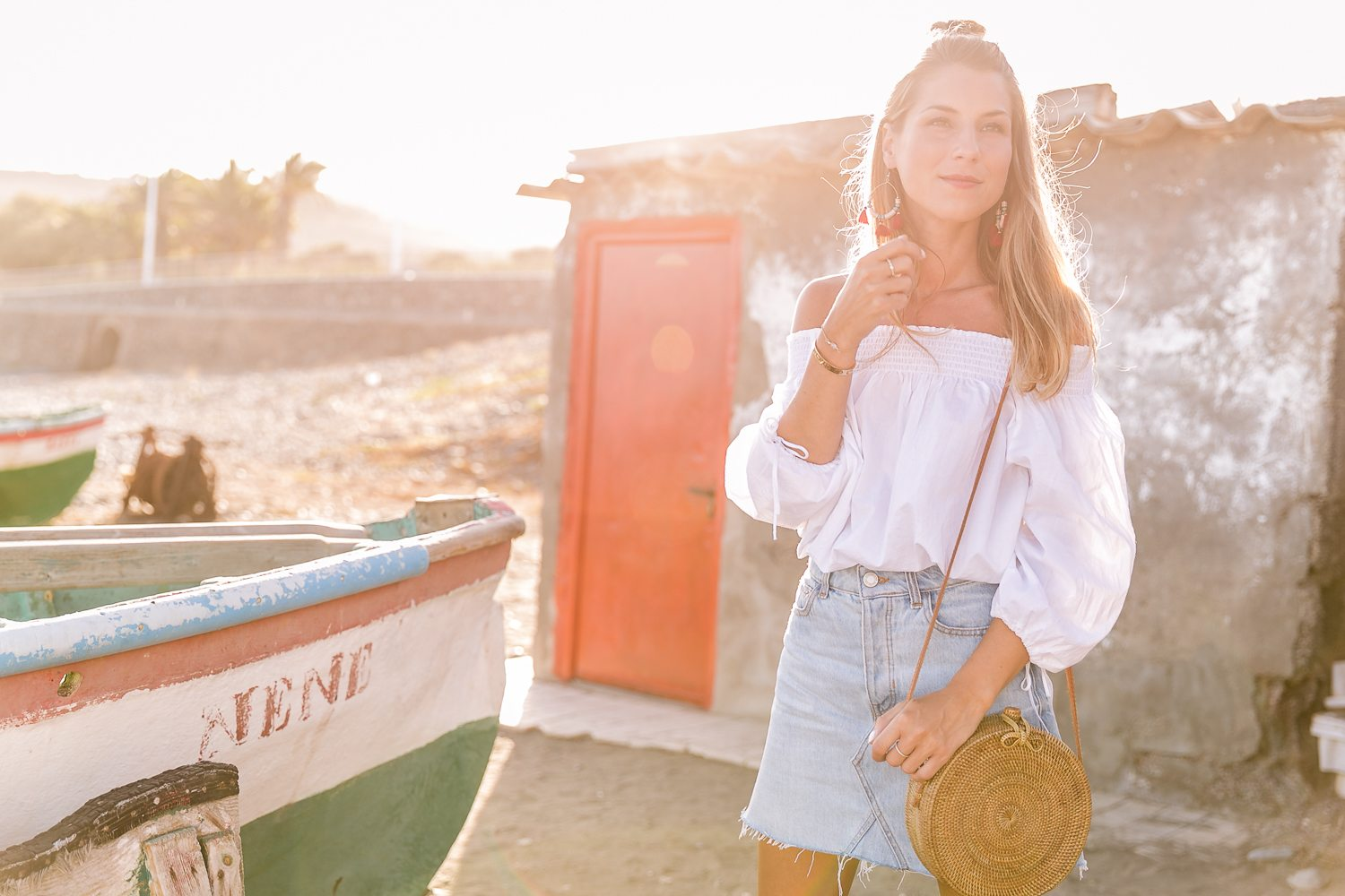 red shoes outfit jeans skirt denim off the shoulder top straw bag summerlook fashionblog 8