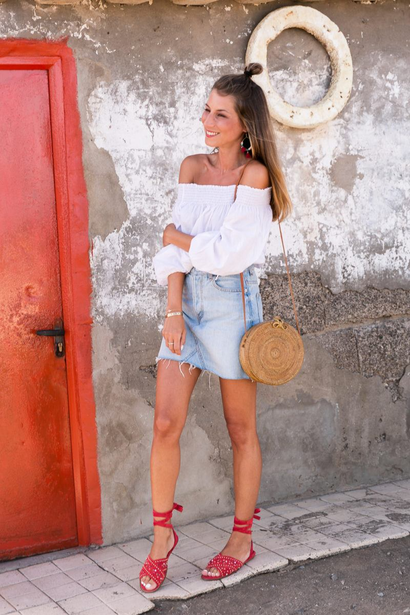 red shoes outfit jeans skirt denim off the shoulder top straw bag summerlook fashionblog 2