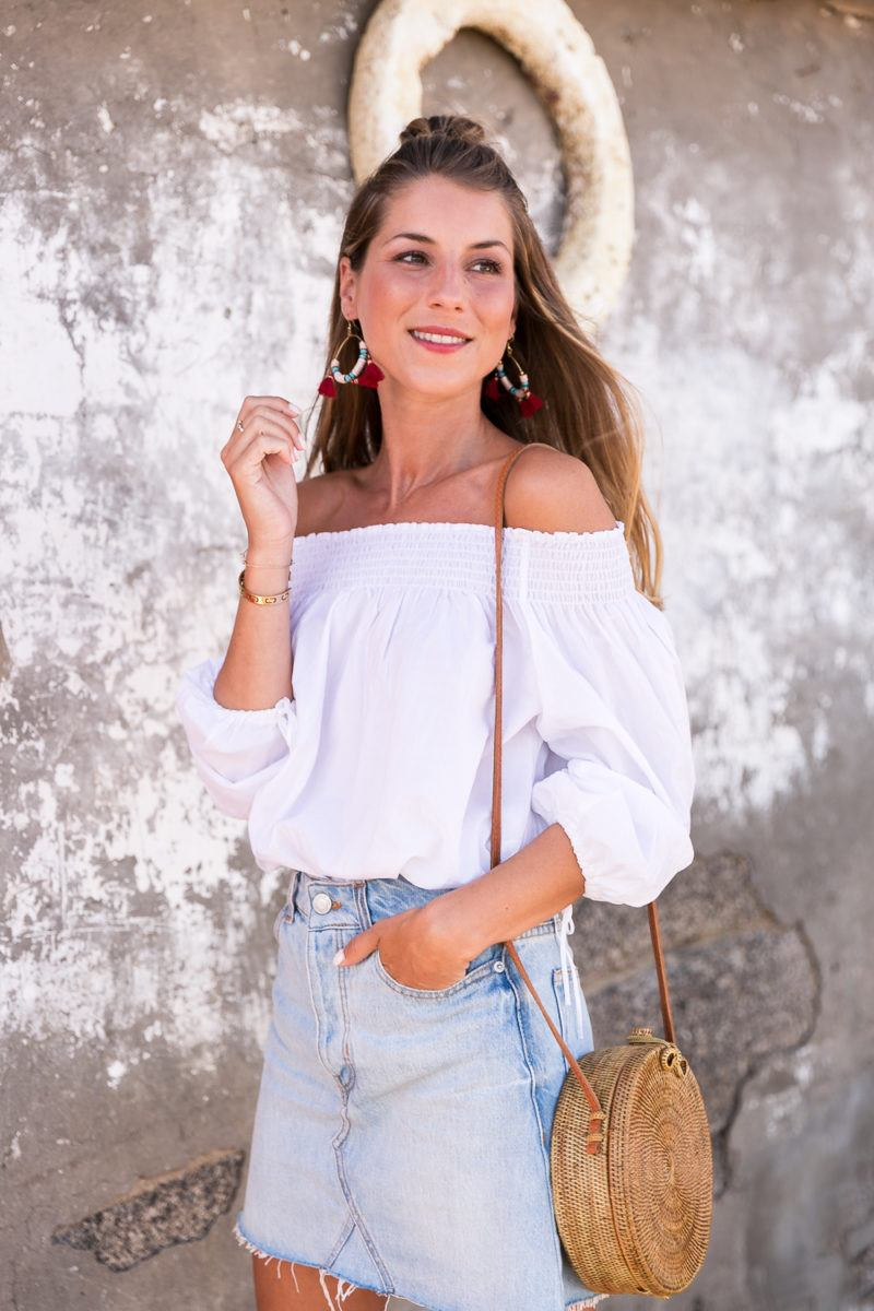 red shoes outfit jeans skirt denim off the shoulder top straw bag summerlook fashionblog 3