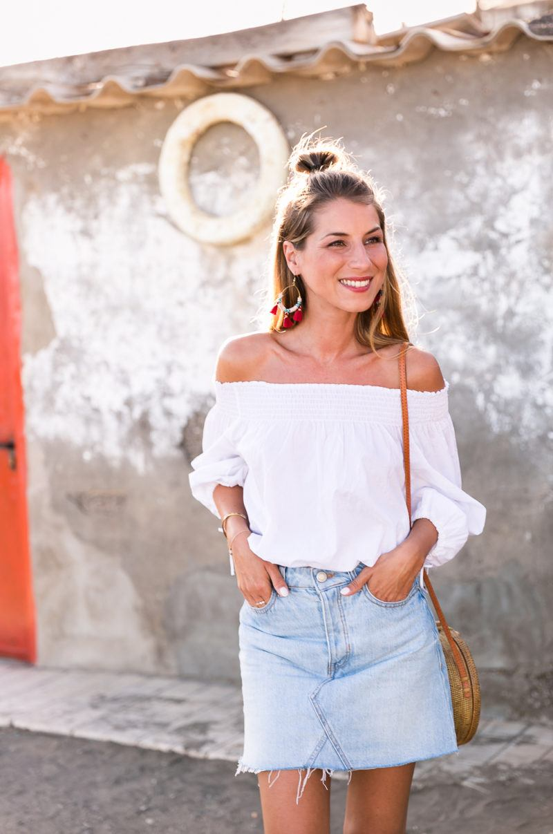 red shoes outfit jeans skirt denim off the shoulder top straw bag summerlook fashionblog 4