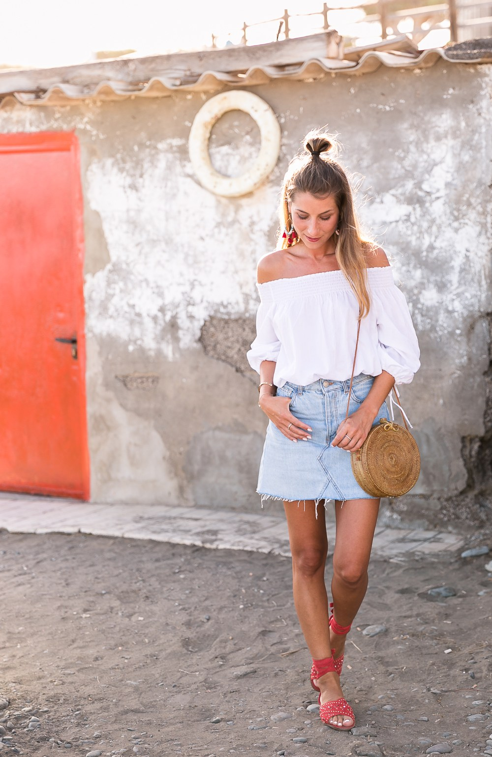 red shoes outfit jeans skirt denim off the shoulder top straw bag summerlook fashionblog 5