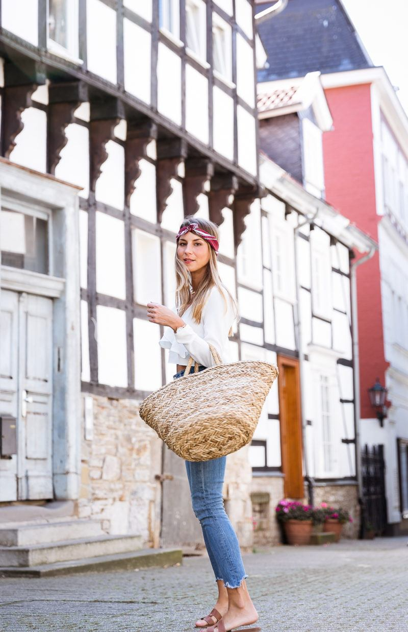 straw bag bandana hair band casual summer outfit jeans white ruffle top hermes oran sandals modeblog streetstyle inspiration